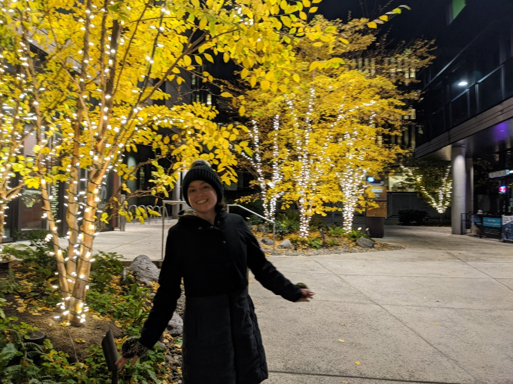 Celeste posing under twinkle lights